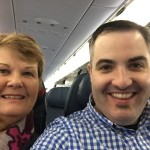 My mom and I on our return flight before we passed out!